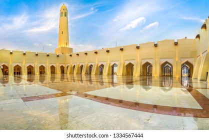 Doha, Qatar - February 21, 2019: panoramic courtyard with minaret and domes reflecting at blue hour. Imam Abdul Wahhab Mosque or Qatar State Mosque in Middle East. The Grand Mosque is in West Bay.