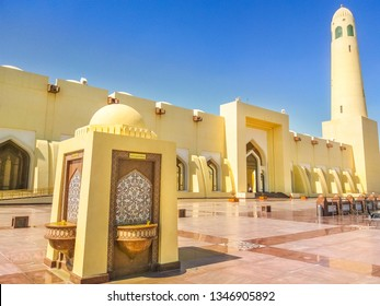 Doha, Qatar - February 21, 2019: drinking fountains outdoor of State Grand Mosque with a minaret on a suny day. Doha mosque in Downtown, Qatar, Middle East, Arabian Peninsula.