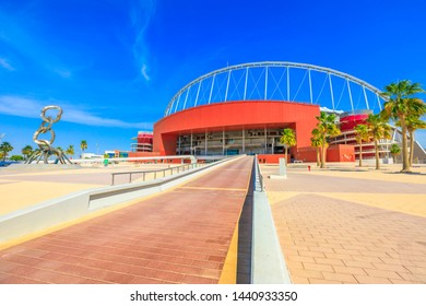Doha, Qatar - February 21, 2019: entrance of Khalifa National Stadium, completed, renovated, covered with air conditioning, main stadium of Qatar in Aspire Park, will host the 2022 World Cup. Blue sky