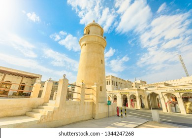 Doha, Qatar - February 23, 2019: Al Ahmad Mosque, ancient mosque with its minaret in the heart of Souq Waqif, old traditional market in Doha center. Sunny day. Mosque at Souq waqif.