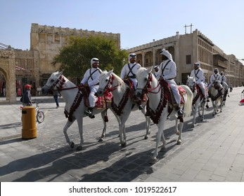 DOHA, QATAR - FEBRUARY 7: Mounted police patrol the main thoroughfare of Souq Waqif market on February 7, 2018 in Qatar, Middle East.