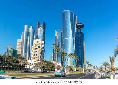 Doha, Qatar - Jan 8th 2018 - The modern downtown of Doha city with palm tree, cars, wide avenues on a blue sky day in Doha City, capital of Qatar in the Middle East.