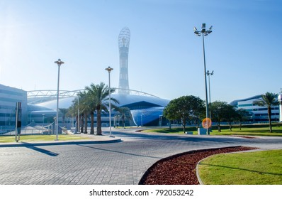 DOHA, QATAR - JANUARY 12: The Aspire Park and Aspire Tower or Torch Hotel in Doha Sports City at morning. January 12, 2018 in Doha, Qatar, Middle East