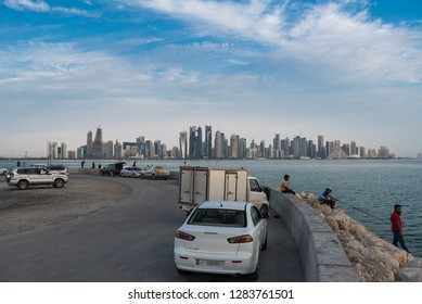 DOHA, QATAR - JANUARY 14: People sitting and fishing at Doha corniche on January 14, 2019 in Doha, Qatar.