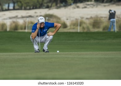 DOHA, QATAR - JANUARY 26: Alexander Noren lines up his putt on the 9th hole during the US$2.5 million Commercial Bank Qatar Masters on January 26, 2013 in Doha Qatar.