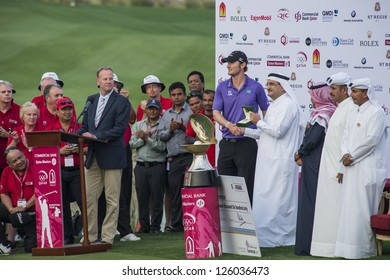 DOHA, QATAR - JANUARY 26: Chris Wood receiving a Rolex watch after winning the US$2.5 million Commercial Bank Qatar Masters in style with an eagle putt on the 18th on January 26, 2013 in Doha Qatar.