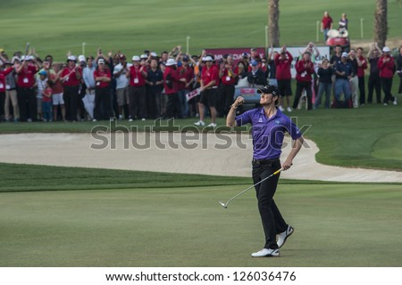 DOHA, QATAR - JANUARY 26: Chris Wood wins the US$2.5 million Commercial Bank Qatar Masters in style with an eagle putt on the 18th on January 26, 2013 in Doha Qatar.