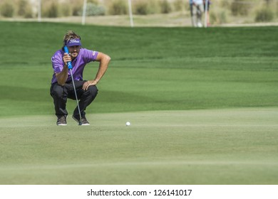DOHA, QATAR - JANUARY 26: Victor Dubuisson lines up his putt on the 9th hole during the US$2.5 million Commercial Bank Qatar Masters on January 26, 2013 in Doha Qatar.