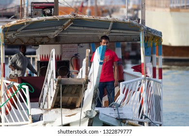 DOHA, QATAR - January 30, 2017: A dhow used for pleasure trips heads for its mooring spot on the Corniche in Doha Bay