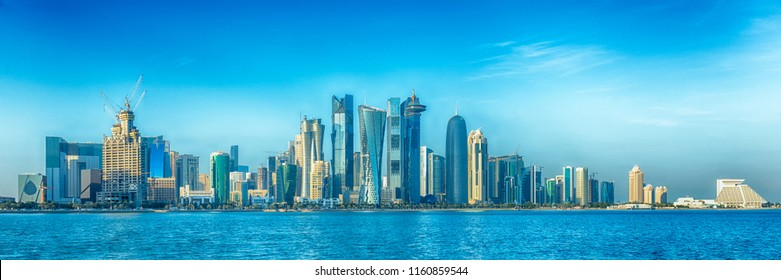 DOHA, QATAR - January 31, 2016: HDR version of a  view of Qatar's towers from Doha Bay, with visible logos.