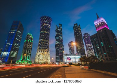 Doha, Qatar - JANUARY 8, 2019: The illuminated, modern skyscrapers of the West Bay district in Doha, Qatar.