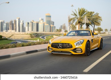 Doha, Qatar - July 06, 2019 : Yellow luxury Mercedes Benz AMG Super car on Doha Roads