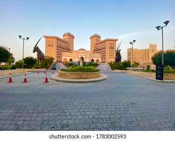 Doha, Qatar - July 15, 2020: Beautiful sunset  Exterior view of St Regis Hotel in Doha.