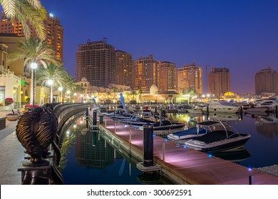 DOHA, QATAR - JULY 28: The Pearl-Qatar on July 28, 2015 in Doha is an artificial island with a residential development of luxury villas and apartment towers target at the wealthy community.