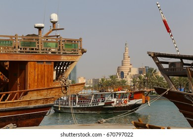 DOHA, QATAR - JULY 3, 2017: The landmark spiral minaret in central Doha seen beyond dhows moored in the bay on the day the Saudi ultimatum to Qatar expired