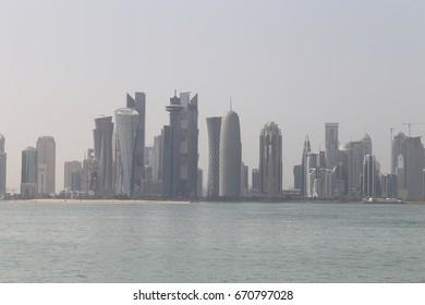 DOHA, QATAR - JULY 3, 2017: Doha's towers, seen across the humid Gulf waters as the Saudi ultimatum expired