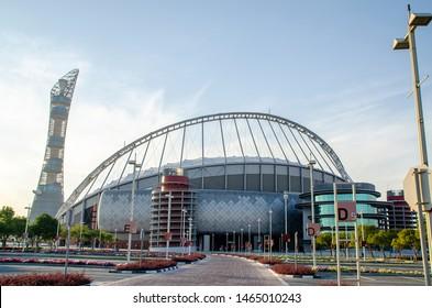 Doha, Qatar - July 30 2019: Khalifa International Stadium, also known as National Stadium, is a multi-purpose stadium in Doha, Qatar. Aspire Tower, also known as The Torch Doha, is a skyscraper hotel.