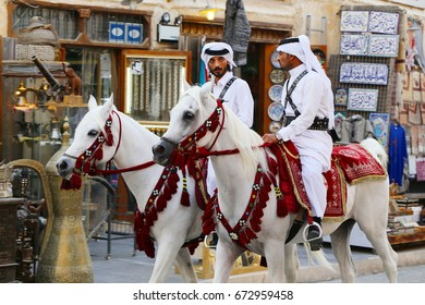 DOHA, QATAR - JULY 6, 2017: Mounted police continue their leisurely patrols of the capital's Souq Waqif market during the diplomatic crisis between Qatar and neighbouring Arab states