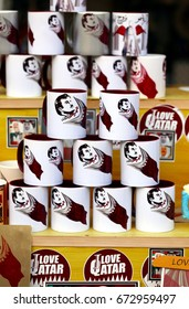 DOHA, QATAR - JULY 6, 2017: Mugs with the national flag and a drawing of  Qatari Emir Sheikh Tamim on sale in the capital's Souq Waqif market during the crisis between Qatar and neighbouring states