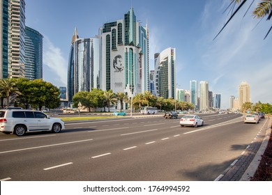 Doha, Qatar - June 10, 2020: Road traffic at financial centre in Doha - The Corniche road with the Public Works Authority, Salaam Tower and Doha Bank tower