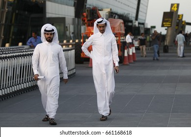 DOHA, QATAR - JUNE 11, 2017. The Qatari men walking at the Hamad International Airport in Doha, Qatar.