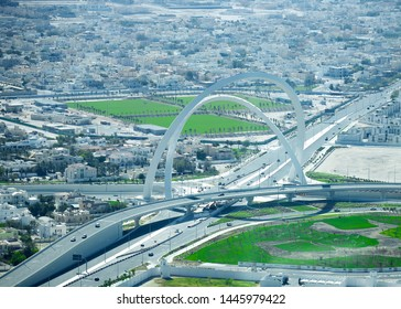 Doha, Qatar - June 28, 2019: Arches at interchange The Tallest Monument of City. known as Bridge of Arch. Doha Ariel View