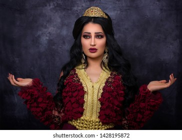 Doha, Qatar: A lady in Moroccan traditional Kaftan dress