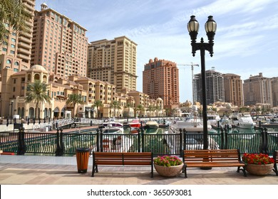 Doha, Qatar - March 21, 2014: The Pearl is an artificial island with resident building, shopping center and restaurant.