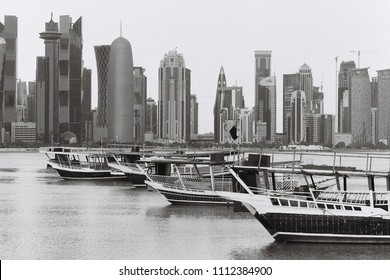 DOHA, QATAR - May 2018: Line-up of dhows in front of the towers lining Doha Bay, Qatar.