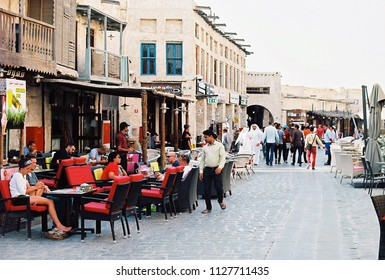 DOHA, QATAR - May 2018: visitors throng a popular coffee shop in Souq Waqif, the main tourist bazaar in the Qatari capital