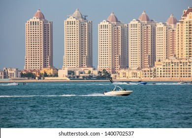 Doha, Qatar - May 2019 : Watersport Recreations Activities including jet-skiing and boating with the background of The Pearl buildings