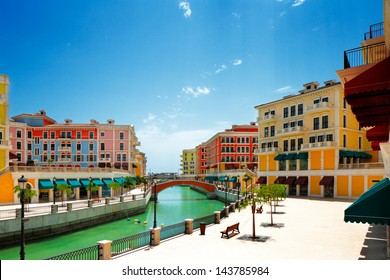 DOHA, QATAR - MAY 3: Qanat Quartier on May 3, 2013 in Doha. Located on the Pearl-Qatar island this Venice-like community has an extensive canal system, squares, plazas and beach front townhouses