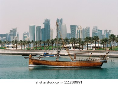 DOHA, QATAR - May 6, 2018: A traditional jalibut sailing dhow, with its distinctive vertical prow, anchored in the museum lagoon. Photo shot on film.