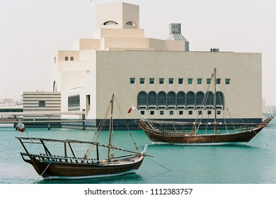 DOHA, QATAR - May 6, 2018: The Museum of Islamic Art in the Qatari capital, with traditional pearling dhows in the foreground. Shot on film.