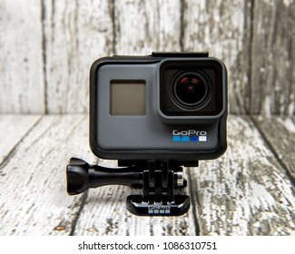 DOHA, QATAR - MAY 8, 2018: GoPro action camera HERO 6 black edition on wooden background.