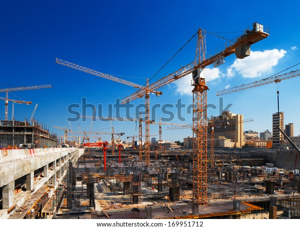 DOHA, QATAR - NOV 13: Construction continues unabated on Nov 13, 2013 in Doha, Qatar. Doha, is preparing it's infrastructure for the World Cup in 2022
