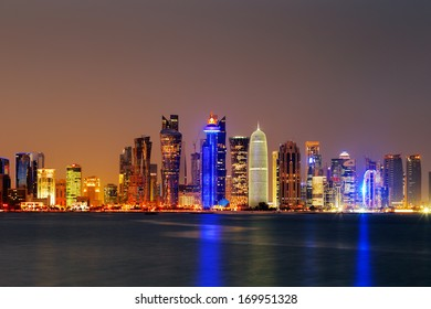 DOHA, QATAR - NOV 14: Iconic new towers grace the skyline of the West Bay area of Doha at dusk on Nov 14, 2013 in Doha, Qatar. The West Bay is considered as one of the most prominent districts of Doha