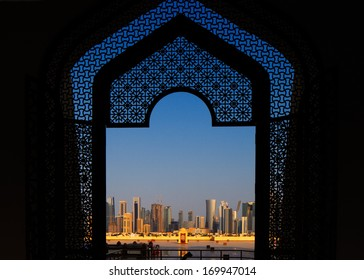 DOHA, QATAR - NOV 15: The West Bay City skyline as viewed from The Grand Mosque on Nov 15, 2013 in Doha, Qatar. The West Bay is considered as one of the most prominent districts of Doha