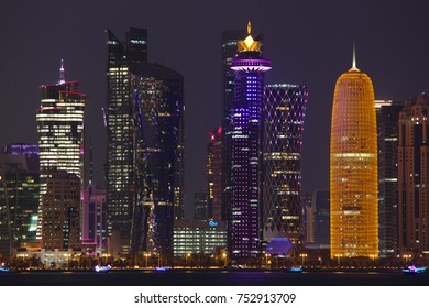 DOHA, QATAR - NOVEMBER 11, 2017: Night view of the city's towers during the diplomatic crisis, with huge pictures of the emir on some.