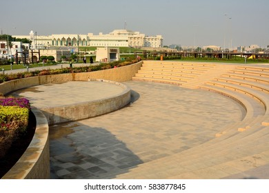 DOHA, QATAR - NOVEMBER 2, 2016. Small amphitheatre in Souq Waqif Park in Doha, with vegetation and buildings in the distance, including governmental offices Amiri Diwan of Qatar.