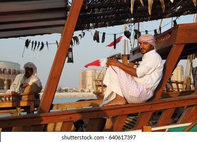 Doha / Qatar - November 2014: Omani sailor taking a break during dhow festival held in Doha / the Dhow Sailor