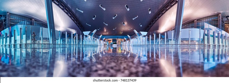 Doha, Qatar - November 2017: Interior shot of departure terminal of Hamad International Airport. The international airport of Doha, home of Qatar airways. Creative and quality image. Panoramic view.