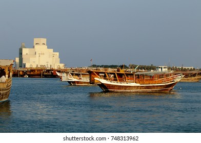 DOHA, QATAR - NOVEMBER 4, 2017:  View from the Corniche in Doha Bay of dhows and the Museum of Islamic Art.