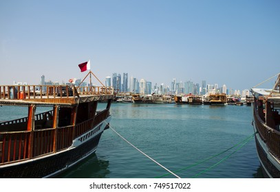 DOHA, QATAR - NOVEMBER 6, 2017: View of Doha Bay from the Corniche, with the distant business towers visible between the dhows.