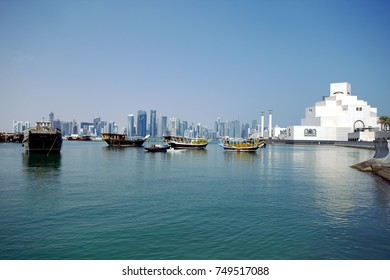 DOHA, QATAR - NOVEMBER 6, 2017: View of Doha Bay from the Corniche, with the distant business towers and the Museum of Islamic Art