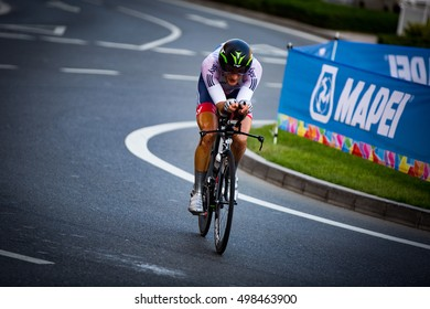 Doha, Qatar - October 12, 2016: British rider Stephen Cummings navigates a roundabout in the men's time trial at the UCI Road World Championships.