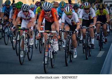 Doha, Qatar - October 15, 2016: The lead group passes by the finish line with one 15-km circuit to go in the women's elite road race at the UCI Road World Championships.