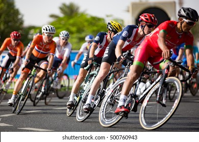 Doha, Qatar - October 16, 2016: Cyclists navigate a roundabout during the elite men's road race at the UCI Road World Championships.