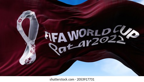 Doha, Qatar, October 2021: A flag with the 2022 Fifa World Cup logo flapping in the wind. The event is scheduled in Qatar from 21 November to 18 December 2022