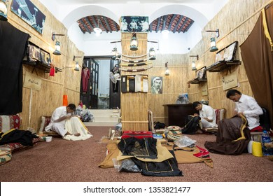DOHA, QATAR - SEPTEMBER 22, 2014: Men's tailor, makers of Arabic clothing bisht and thawb